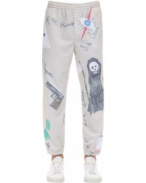 Białe joggery bawełniane z printem Klsh - Kids Love Stain Hands