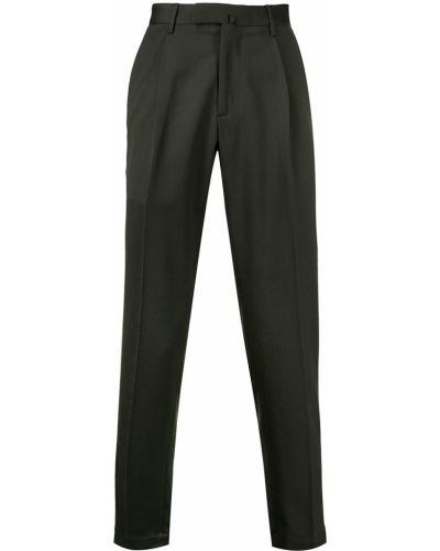 Шерстяные облегающие зеленые деловые зауженные брюки Dell'oglio
