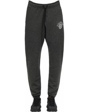 Czarne spodnie do biegania Nike Gyakusou Undercover Lab