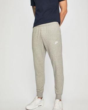 Sport spodnie długo z kieszeniami Nike Sportswear