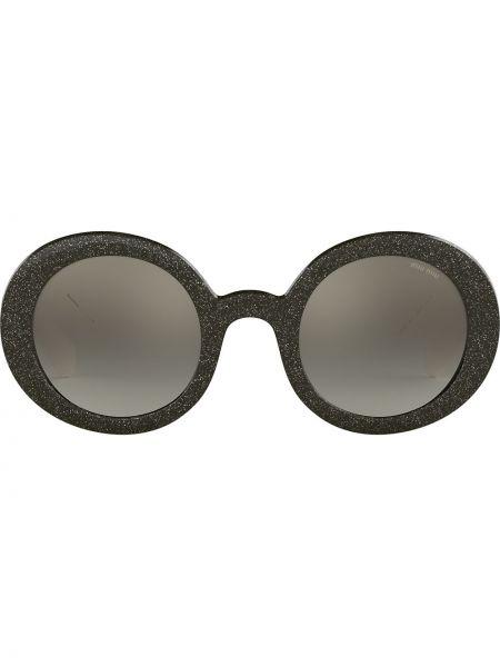 Нейлоновые солнцезащитные очки круглые с глиттером Miu Miu Eyewear