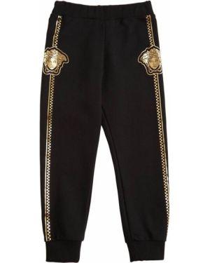 Czarne joggery bawełniane z printem Versace