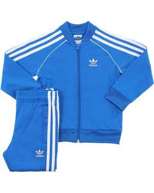 Niebieski garnitur w paski z raglanowymi rękawami Adidas Originals