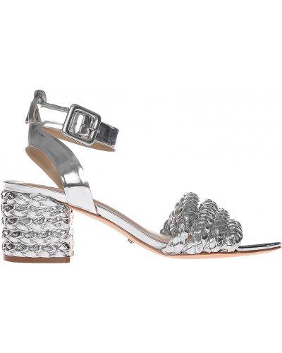 Босоножки на каблуке серебряного цвета Schutz