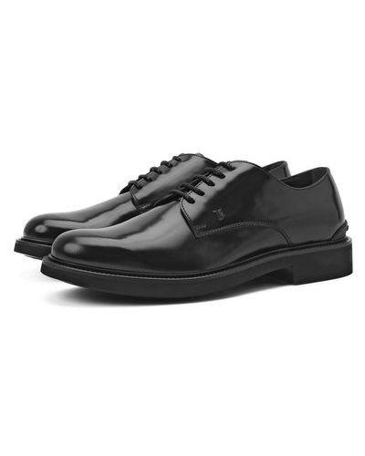Черные итальянские туфли Tods