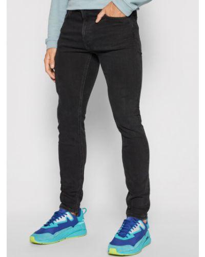 Czarne jeansy rurki Lee