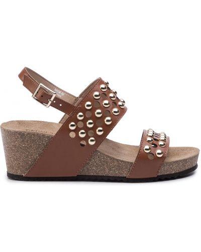 Босоножки на каблуке - коричневые Grunland
