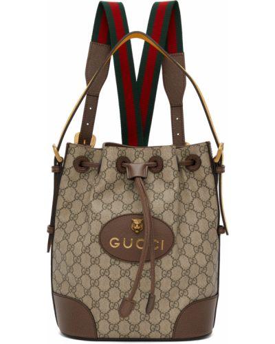 Złoty czarny plecak z klamrą Gucci