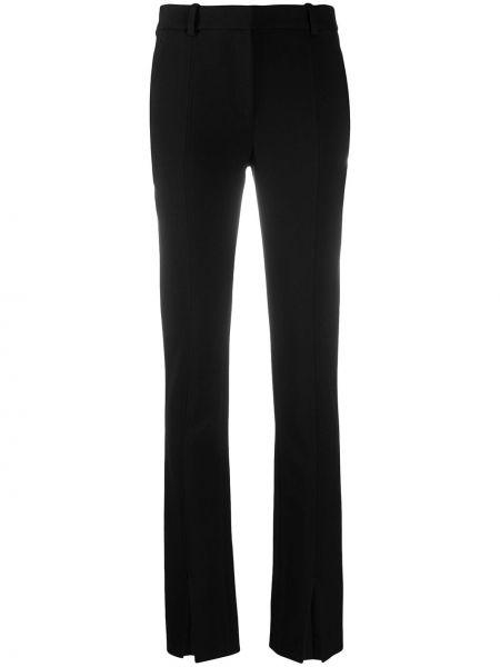 Брючные черные брюки с поясом из вискозы Victoria Beckham