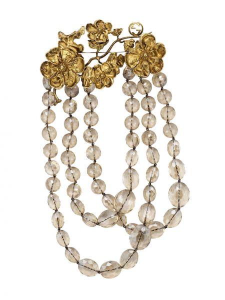 Ażurowa złota broszka Gucci