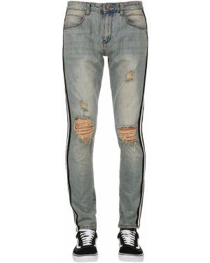 Niebieskie jeansy w paski bawełniane Serenede