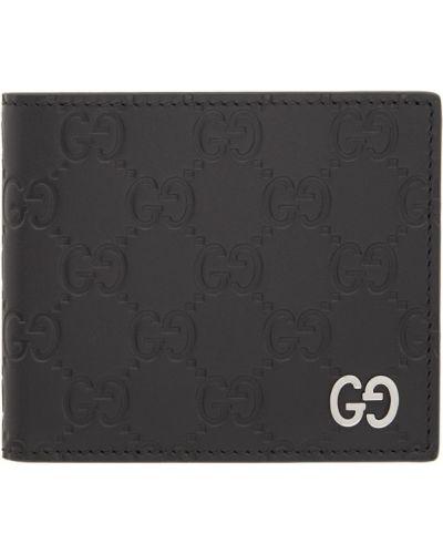 Черный кожаный кошелек с тиснением Gucci