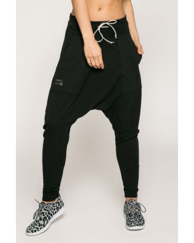 Свободные брюки с карманами с поясом Reebok