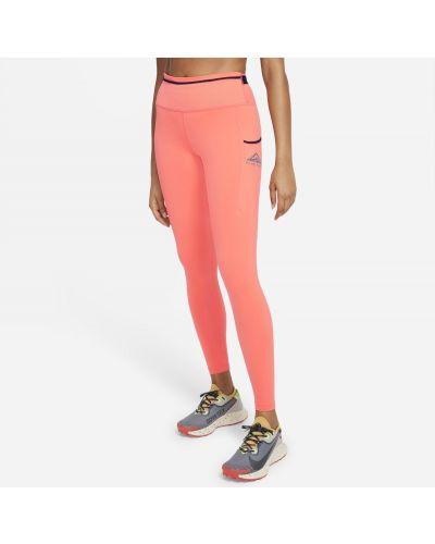 Pomarańczowe legginsy dzianinowe Nike
