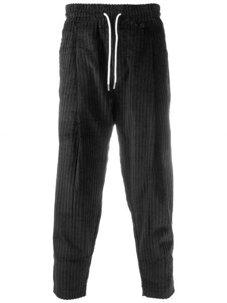 Czarne spodnie z wysokim stanem w paski Drole De Monsieur