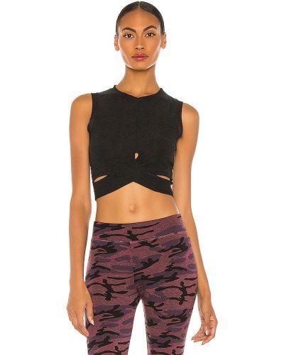 Czarny crop top na jogę z cięciem Beyond Yoga