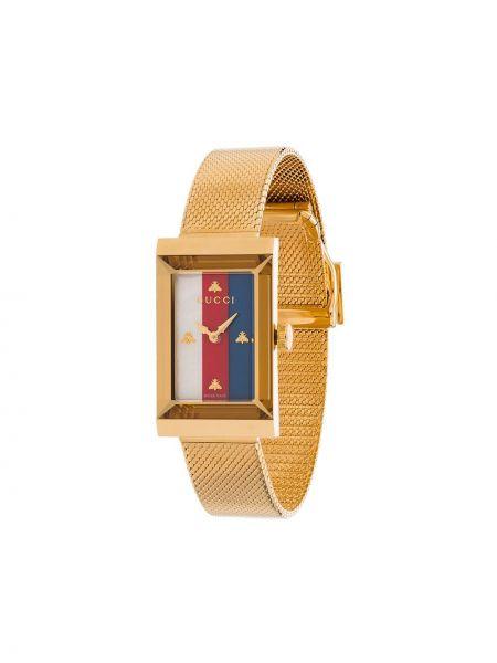 Золотистые часы золотые в полоску Gucci