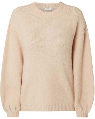 Prążkowany różowy sweter wełniany Edited