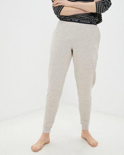 Домашние бежевые брюки Calvin Klein Underwear