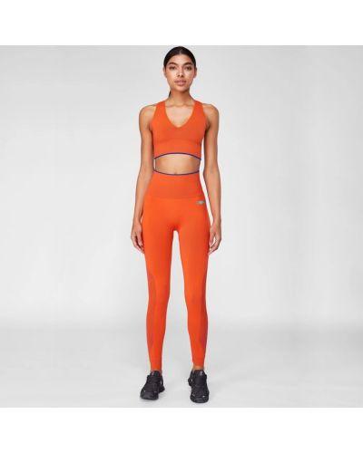 Pomarańczowe legginsy Evveervital