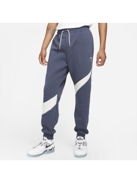Joggery z haftem - niebieskie Nike