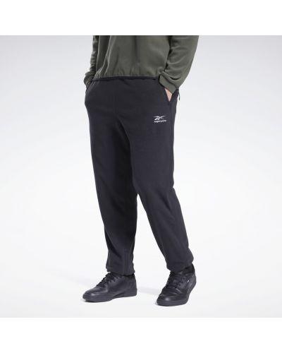 Флисовые черные брюки Reebok