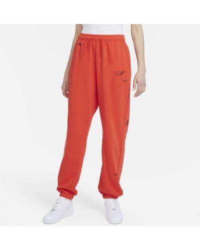 Czerwone spodnie dresowe materiałowe Nike