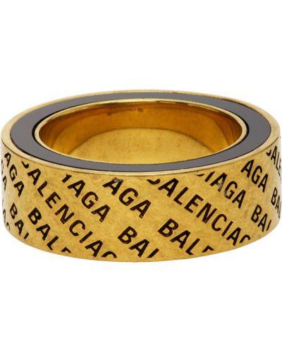 Кольцо из золота черный Balenciaga