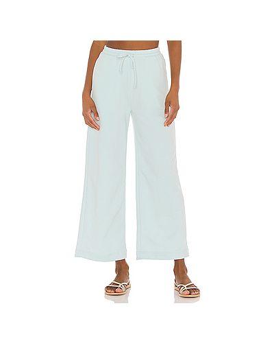 Хлопковые синие брюки с карманами на шнурках Majorelle