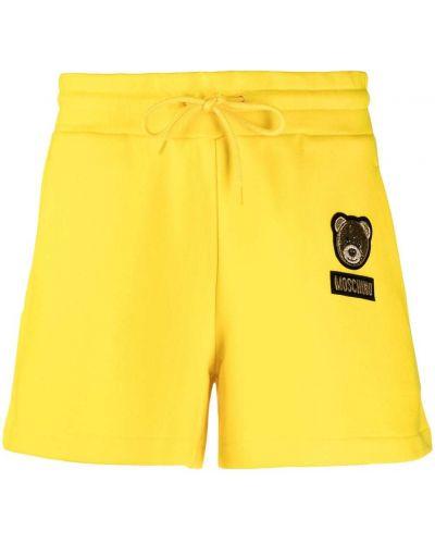 Желтые шорты на шнурках с нашивками Moschino