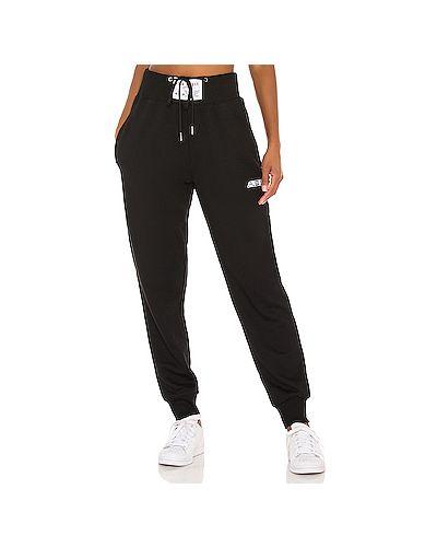 Хлопковые черные брюки на резинке с карманами с декоративной отделкой Adam Selman Sport