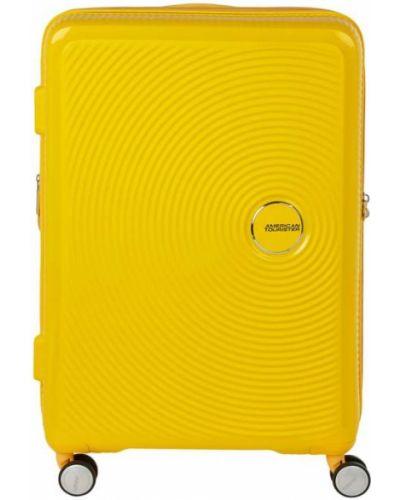 Żółty walizka amerykański z zamkiem błyskawicznym American Tourister