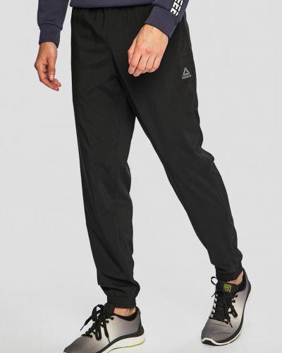 Спортивные брюки на резинке свободного кроя Reebok