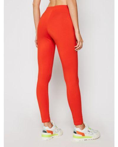 Pomarańczowe legginsy sportowe oversize Champion