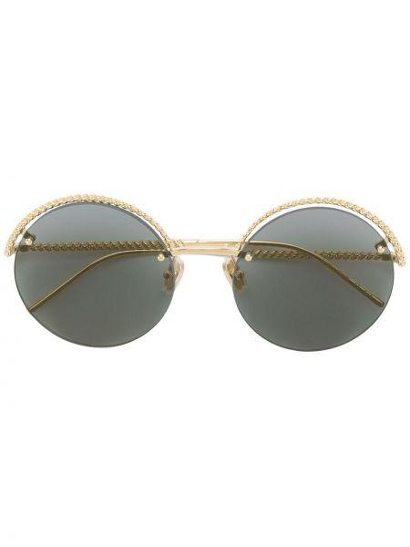 Желтые солнцезащитные очки круглые металлические Boucheron Eyewear