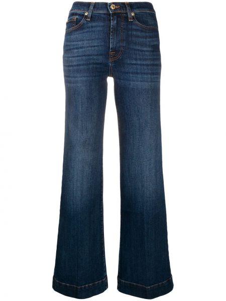 Золотистые хлопковые синие расклешенные джинсы с заклепками 7 For All Mankind