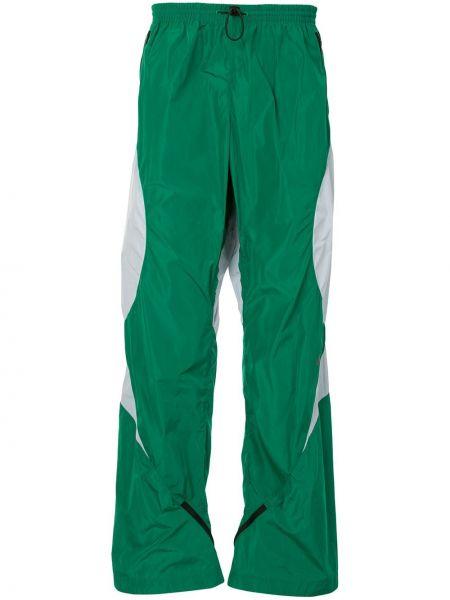 Zielone spodnie z printem Kiko Kostadinov