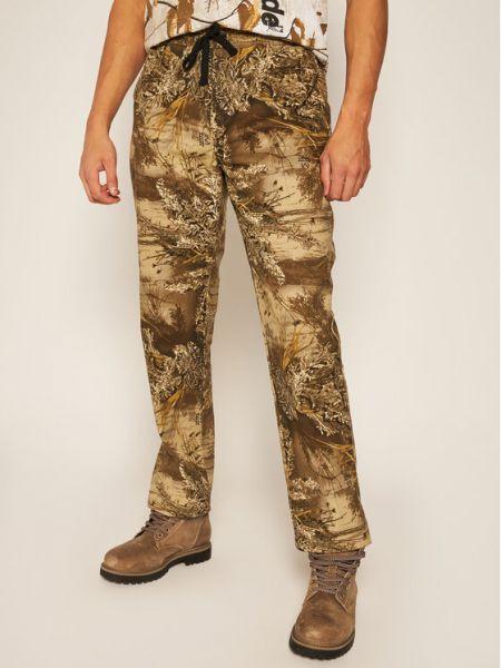 Beżowe spodnie materiałowe Huf