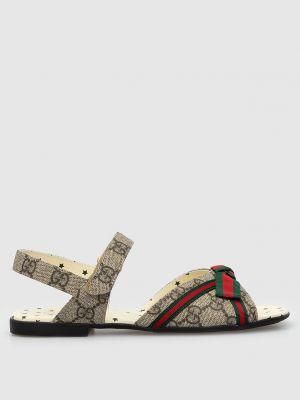 Бежевые сандалии с бантом Gucci