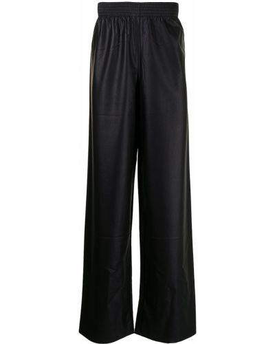 Czarne spodnie skorzane Raf Simons