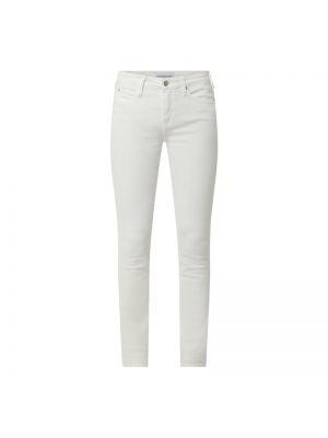 Białe jeansy bawełniane Calvin Klein Jeans