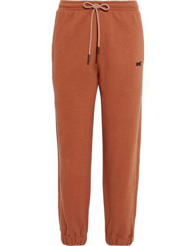 Spodnie bawełniane z haftem Reebok X Victoria Beckham