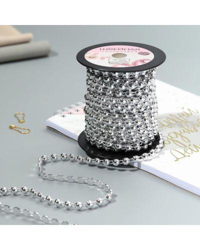 Серебряное ожерелье с жемчугом арт узор