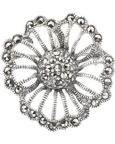 Серебряная брошь с камнями марказит