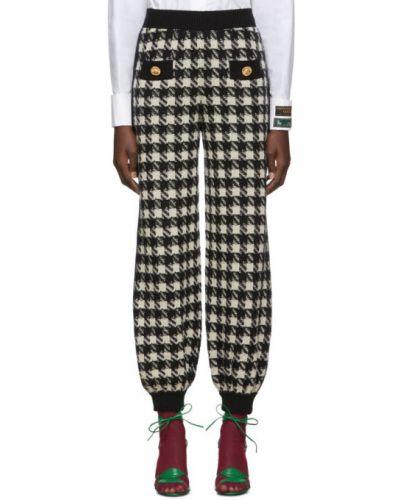 Czarny kaszmir spodnie z mankietami zapinane na guziki Gucci