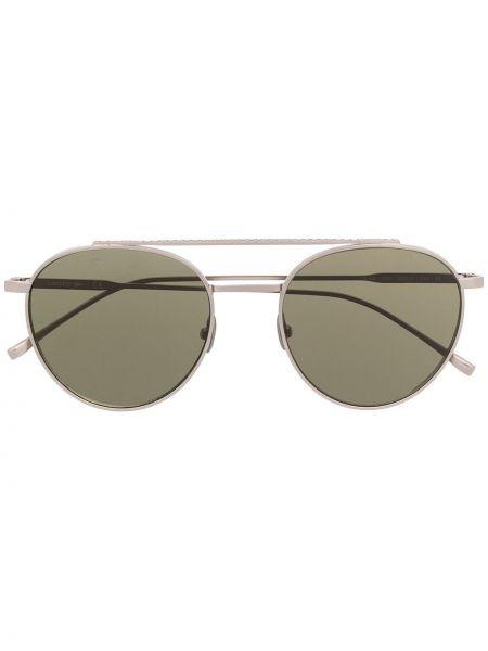 Серебряные солнцезащитные очки круглые металлические Lacoste