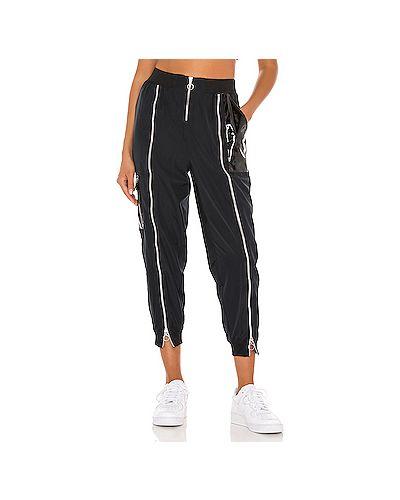 Черные брюки на резинке на молнии Nike