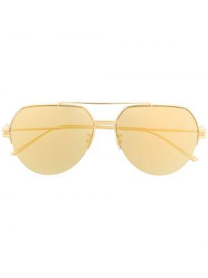 Золотистые желтые солнцезащитные очки металлические Bottega Veneta Eyewear