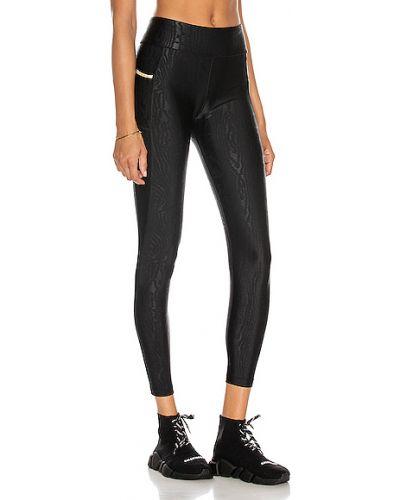 Złote czarne legginsy Alala
