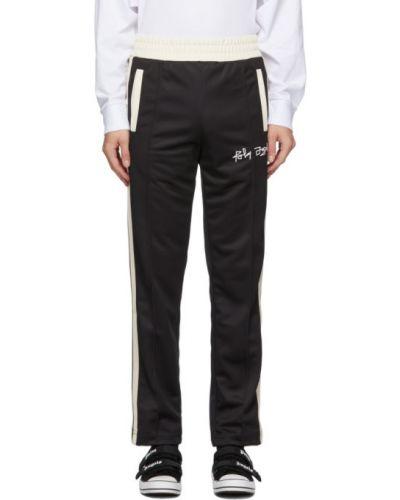 Prosto czarny spodnie o prostym kroju z kieszeniami z czaszkami Palm Angels